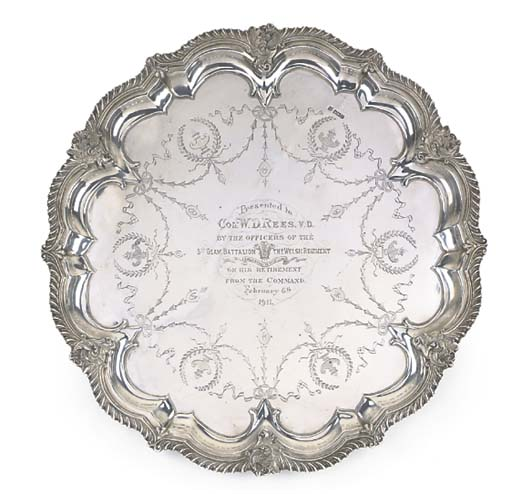 A SHAPED CIRCULAR SALVER SALVE