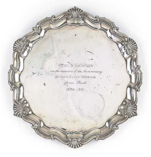 AN EDWARDIAN SILVER SALVER
