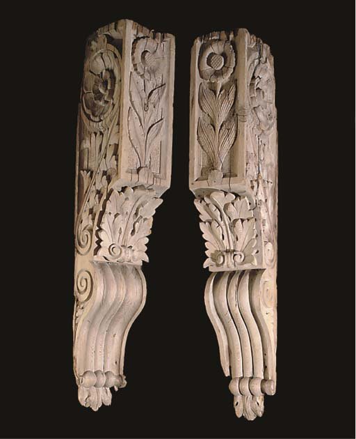 A PAIR OF CARVED PINE CORBELS