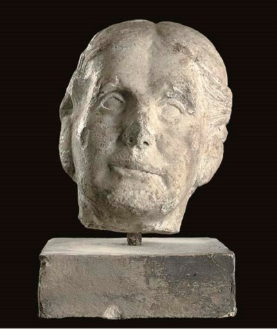 A WHITE MARBLE HEAD OF A LADY