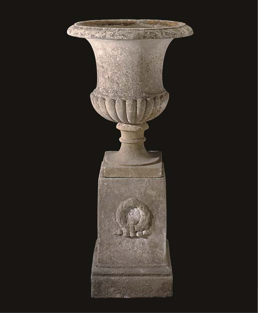 A COMPOSITE STONE URN AND PEDE