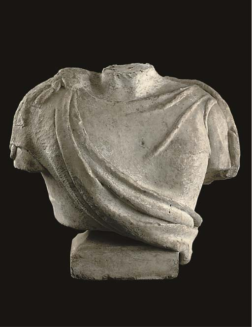 A SCULPTED WHITE MARBLE FRAGME