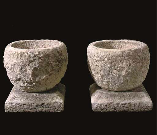 A PAIR OF PORTLAND STONE URNS