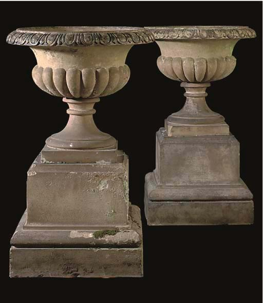 A PAIR OF STONEWARE URNS AND P