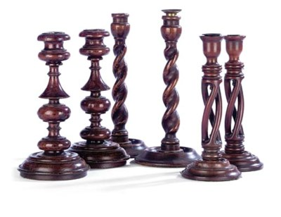 TWO PAIRS OF OAK CANDLESTICKS