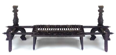 A WROUGHT IRON FIRE GRATE