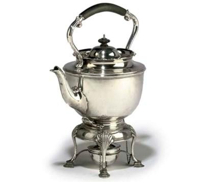 AN EDWARDIAN SILVER TEA KETTLE