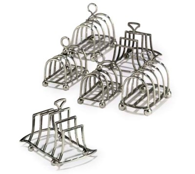 TWO PAIRS OF SILVER TOAST RACK