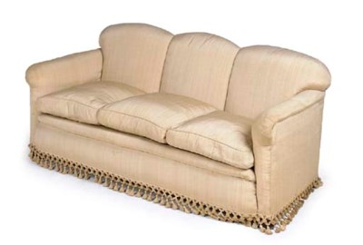 AN UPHOLSTERED THREE SEAT SOFA