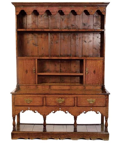 A WELSH OAK AND INLAID DRESSER