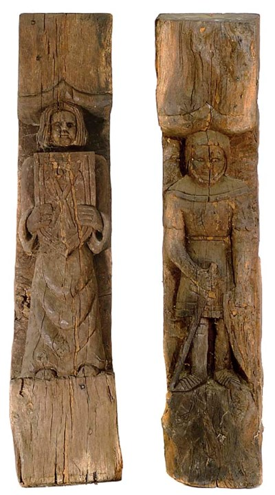 A LARGE PAIR OF CARVED OAK POS