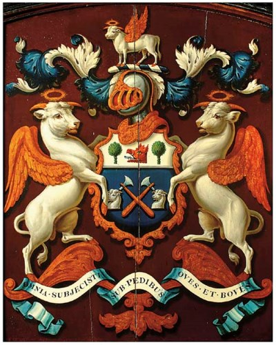 A PAINTED WOOD ARMORIAL PANEL