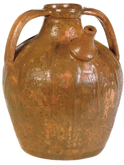 A GLAZED EARTHENWARE JUG