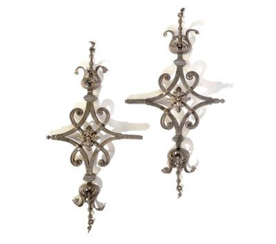 A PAIR OF WROUGHT-IRON ORNAMEN