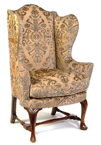 A WALNUT AND ELM WING ARMCHAIR