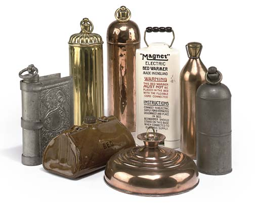 A COLLECTION OF BRASS COPPER POTTERY AND CERAMIC WARMERS
