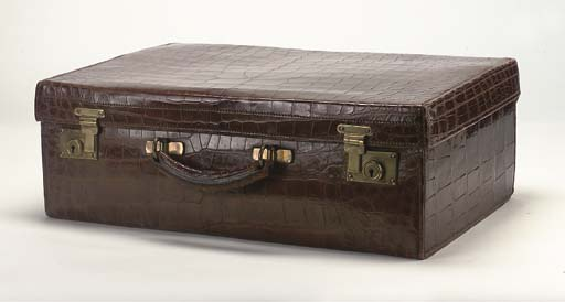 A CROCODILE SUITCASE WITH WEAT
