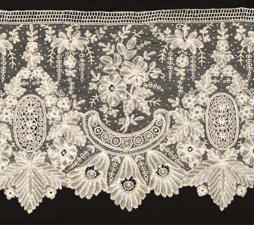 A MIXED BRUSSELS LACE FLOUNCE,
