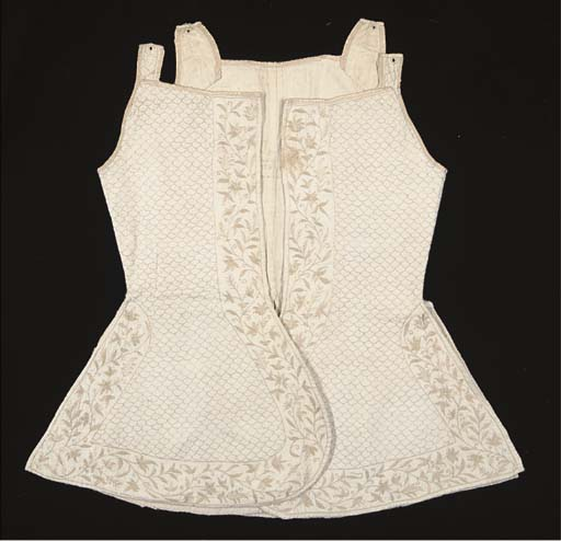 A LADY'S QUILTED AND EMBROIDER