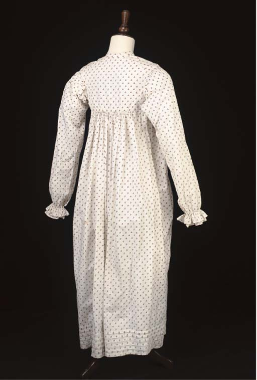 A DAY DRESS OF SPRIGGED COTTON