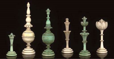 A TURNED AND CARVED IVORY CHES