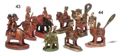 A GROUP OF FOUR INDIAN GILT-HE