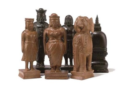 A CEYLONESE CARVED EBONY AND S