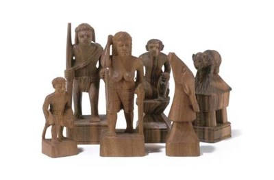A PHILIPPINE CARVED EBONY AND