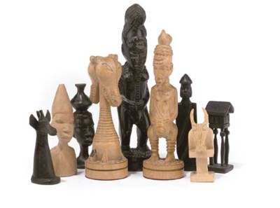 AN AFRICAN CARVED EBONY AND HA
