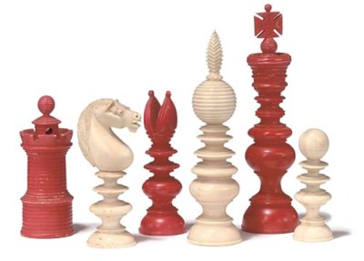 AN ENLISH TURNED IVORY CHESS S