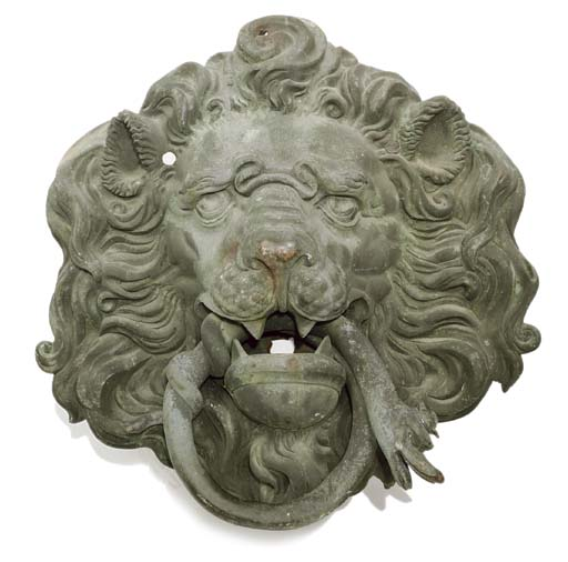 A LARGE BRONZE LION MASK PANEL