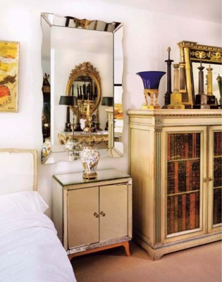 A MIRRORED SIDE CABINET