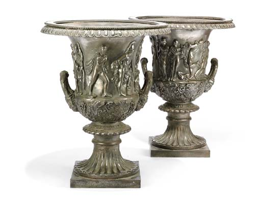 A PAIR OF CAST IRON MODELS OF