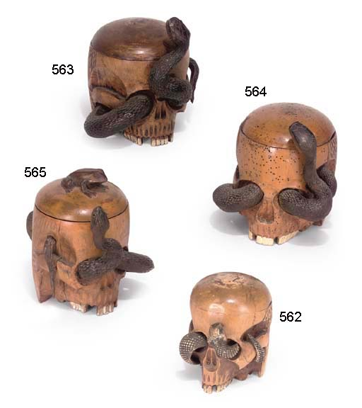 A CARVED STAINED WOOD TOBACCO