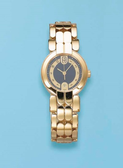 AN 18K GOLD LADY'S WRISTWATCH,
