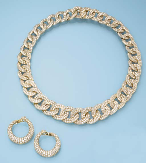 A DIAMOND AND 18K GOLD SET, BY