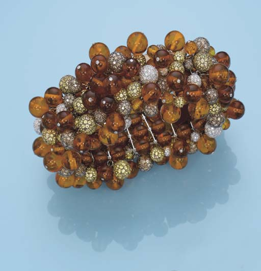 AN AMBER AND DIAMOND BRACELET,