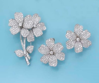 A DIAMOND FLORAL BROOCH AND EA