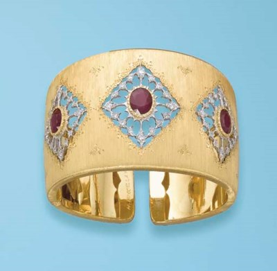 A RUBY AND 18K GOLD BANGLE, BY