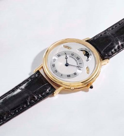 Breguet. A fine 18K gold self-
