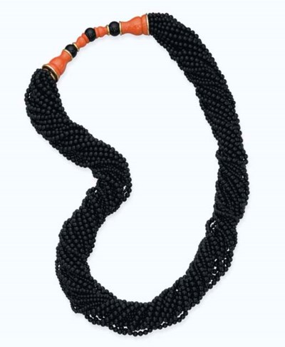AN ONYX AND CORAL MULTI-STRAND