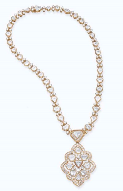 A DIAMOND AND 18K GOLD PENDENT