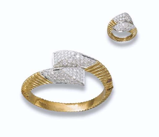A DIAMOND AND GOLD SET, BY KUT