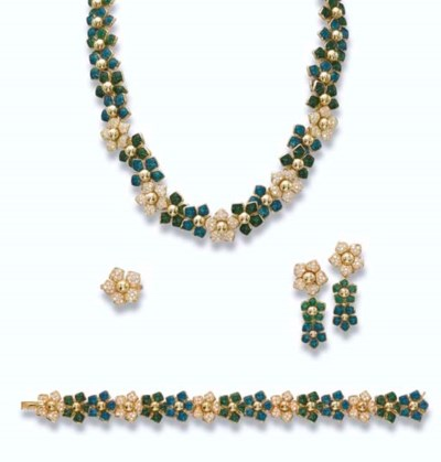 AN ENAMEL AND DIAMOND FLORAL S
