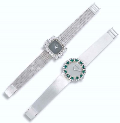 A LADY'S DIAMOND AND EMERALD W