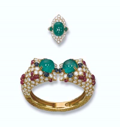 A GEM-SET AND DIAMOND BANGLE,