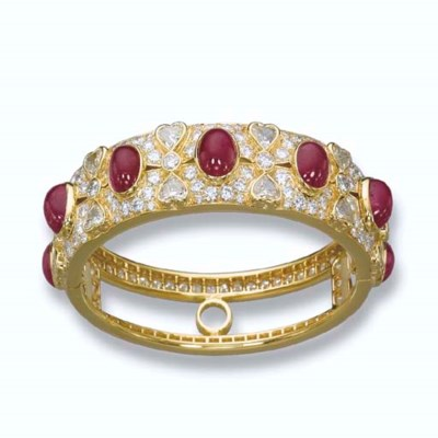 A RUBY AND DIAMOND BANGLE, BY