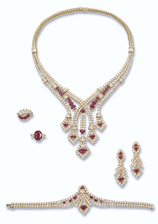 A RUBY AND DIAMOND SET AND TWO