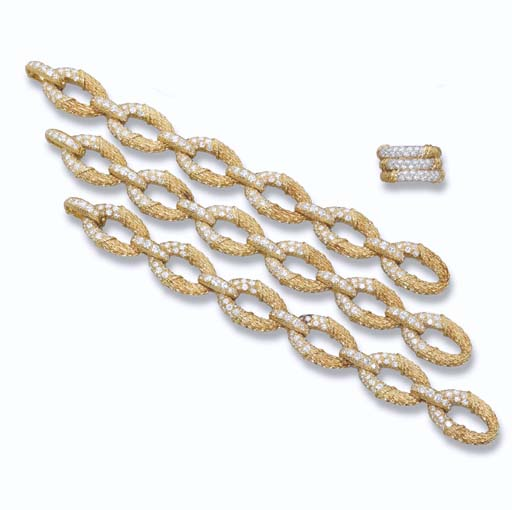 A GOLD AND DIAMOND NECKLACE/BR
