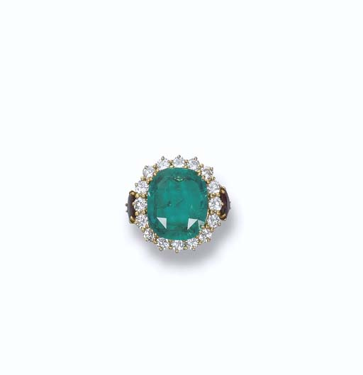 AN EMERALD AND GEM-SET RING